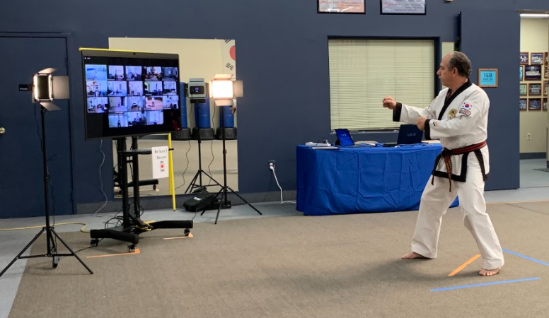 Martial Arts instructor Brian Manna conducting instruction via Zoom on DTEN D7 All-in-one video collaboration device